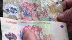 Sự thật về tiền giả qua các chữ cái đầu seri