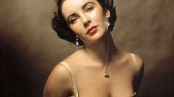 """Cách giảm cân kỳ lạ của """"huyền thoại mắt tím"""" Elizabeth Taylor"""