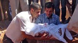 Nỗi đau vỡ òa phút tiễn đưa bé trai Syria chết đuối