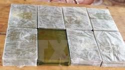 Vận chuyển 20 bánh heroin để lấy... 600.000 đồng tiền công