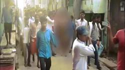 Người phụ nữ khốn khổ bị đốt nhà, đánh đập, lột đồ diễu phố ở Ấn Độ