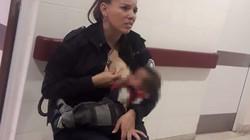 Nữ cảnh sát Argentina cởi áo cho em bé bú nhận tin vui