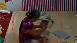 Nữ giúp việc đánh liên tục cháu bé vì không chịu uống sữa