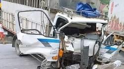 Xe tải nát bét phần đầu, tài xế mắc kẹt trong cabin sau va chạm với container