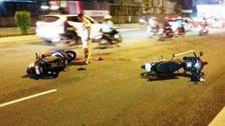 Hai người đàn ông nằm bất động trên đại lộ sau tai nạn