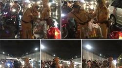 """Dân mạng chia sẻ """"rần rần"""" ảnh CSGT phát áo mưa trong đêm Trung thu"""