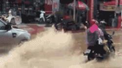 Cô giáo lái xe hơi tạt nước ướt đẫm người đi đường lên tiếng xin lỗi