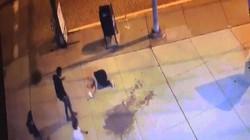 Thấy người bị đấm ngã ra đường, dân Mỹ chụp ảnh, cướp bóc