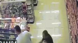 Cảnh sát Brazil một tay bế con, một tay bắn cướp như phim