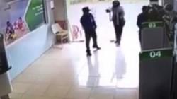 Cần khởi tố thượng úy công an cầm súng xông vào ngân hàng tội cướp