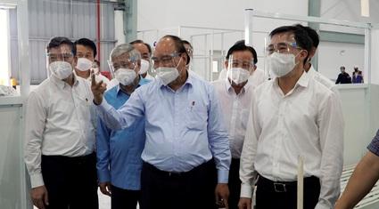 Chủ tịch nước Nguyễn Xuân Phúc: Phát huy vai trò của Tổ Covid-19 cộng đồng, giảm tải cho đội ngũ y tế