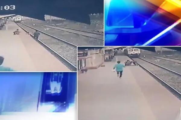"""Chạy đua với tàu, nhân viên đường sắt cứu em bé thoát khỏi """"tử thần"""""""