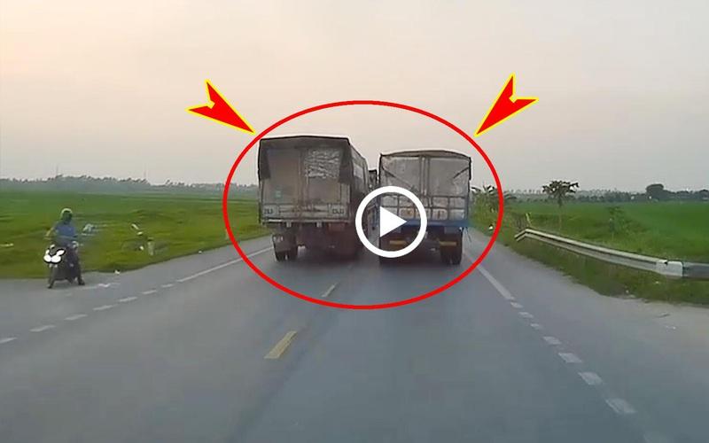Clip: Xe tải chèn ép nhau giành đường bất chấp đi trái chiều
